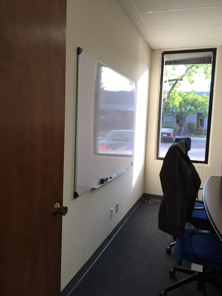 Meeting room with whiteboard (Before Photo).
